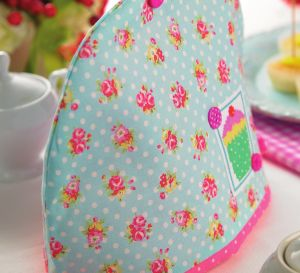 Cotton print and cross-stitch tea cosy