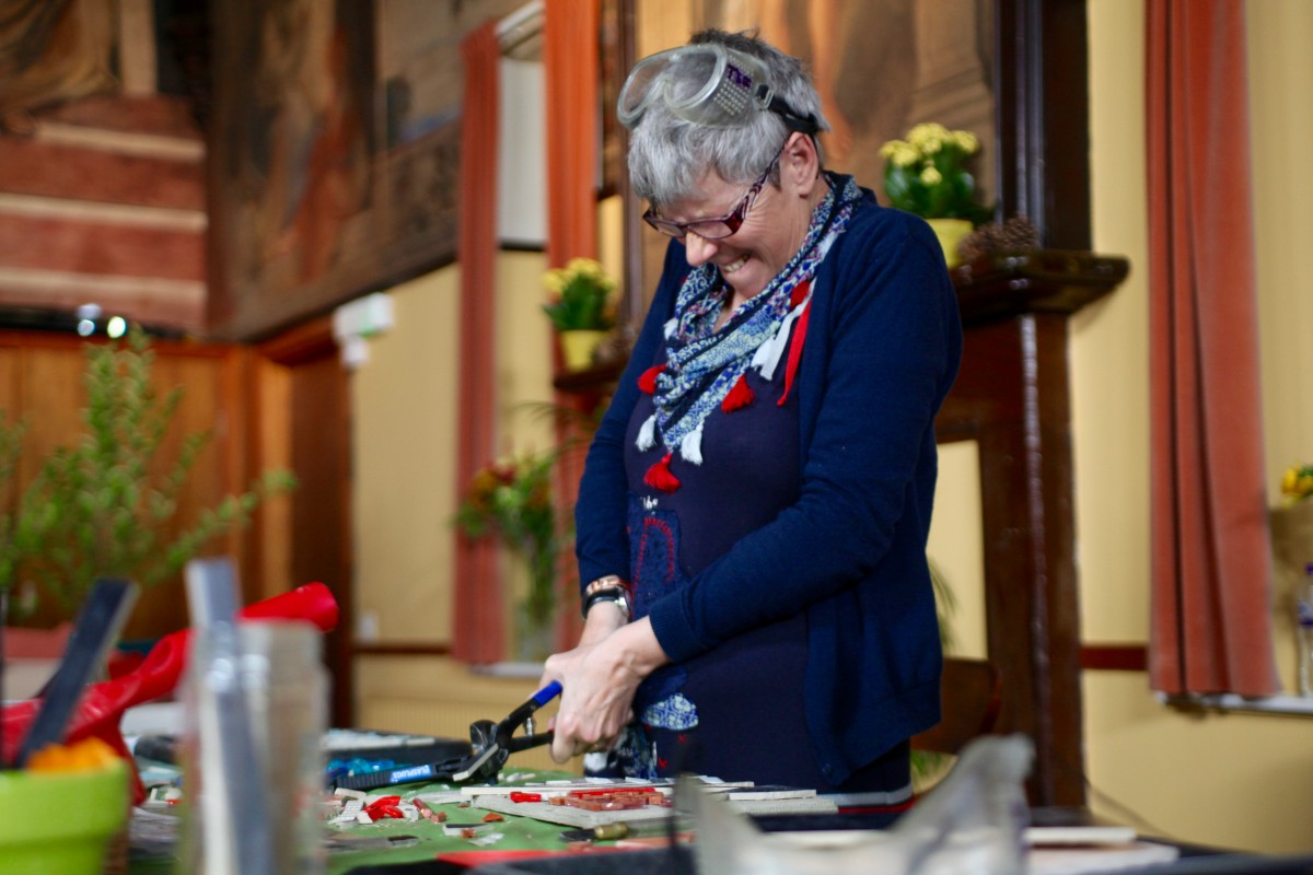 Cheryl Stewart summoning the strength to cut tiles!